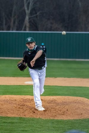 Waxahachie's Jared Thomas wheels and deals during Friday's Robert Dulin Memorial Tournament game against Midlothian at Richards Park. Thomas took a no-hitter into the sixth inning as the Class 6A No. 10-ranked Indians blanked the Panthers, 4-0.