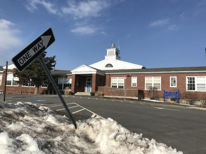 Snow melts near the LPS Administration Building in early March. Officials announced that the spring will bring a full return to school for many students.