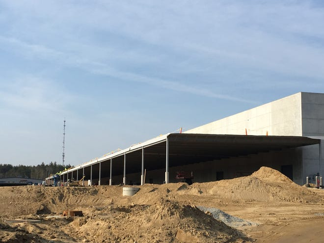 Work continues on the new Amazon facility on the Plymouth and Kingston line.