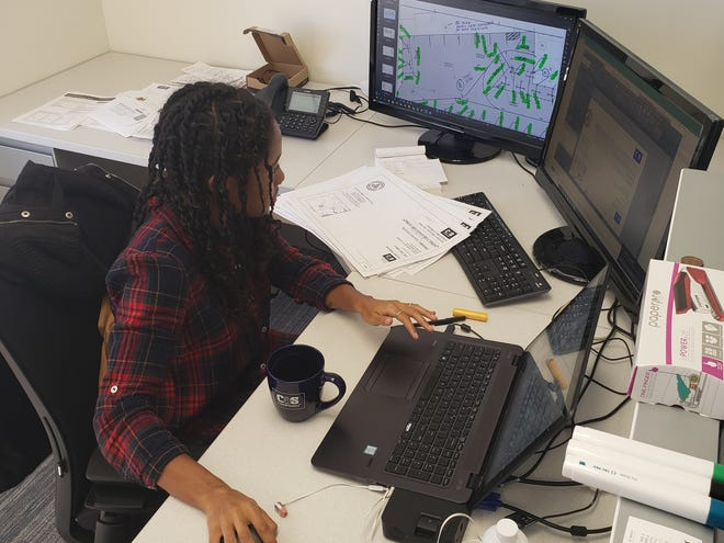 Suber working as a Civil Engineer. Less than 2 percent of Black freshmen in the United States enter college engineering programs.