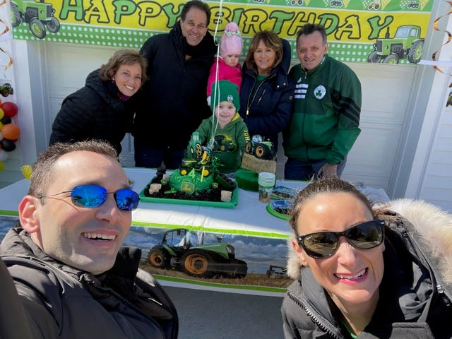 The Merlina family celebrates Anthony's fourth birthday with a cake outside after a vehicle drive-by parade. Pictured are Toni-ann Merlina, Mark Merlina, Anthony Merlina, Julianna Merlina, Nino Bertolino, Connie Bertolino, Joseph Merlina and Patti Merlina.