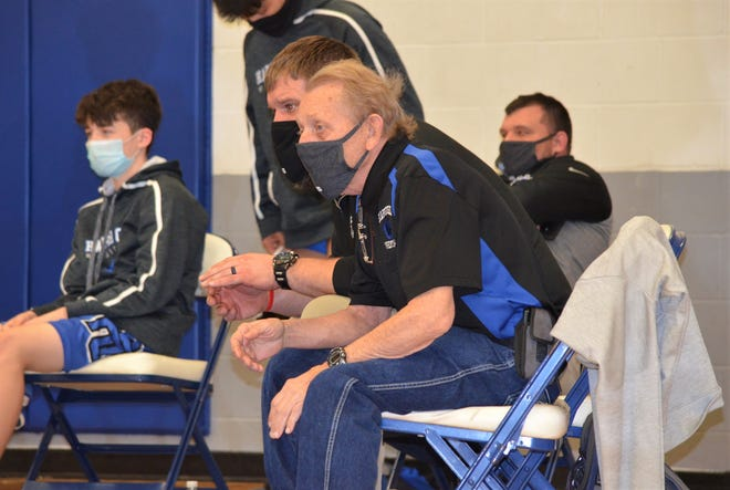 Harper Creek wrestling coach Dave Studer, right, with assistant coach Joe Yurisich at a wrestling quad at Harper Creek High School on Saturday. Studer has coached at Harper Creek for 55 seasons and recently earned his 600th win.
