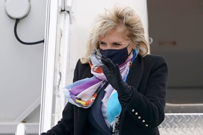 First lady Jill Biden waves as she arrives at Joint Base Lewis-McChord in Washington state on Monday.