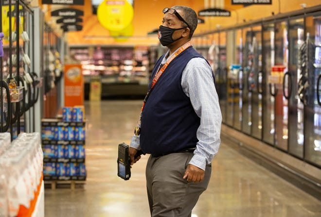 Larry Yates, an assistant store leader at the Kroger North College Hill location, was working at the Madeira Kroger on special assignment, Tuesday, March 2, 2021.