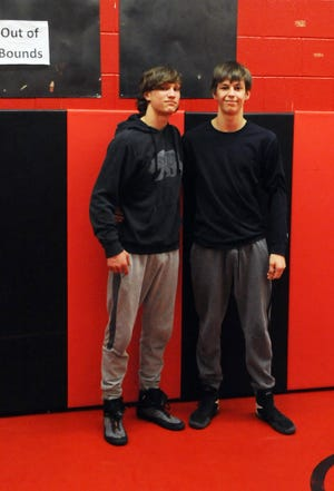 Ridgewood's Jesse Maple (left) and Coshocton's Ethan Dixon will represent Coshocton County in the Division III state wrestling meet this weekend at Marion Harding High School.