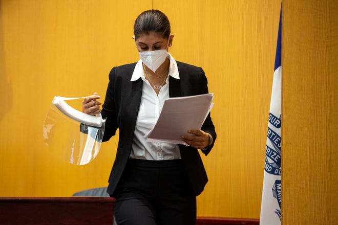 Des Moines Register reporter Andrea Sahouri leaves the stand after testifying, on March 9 at the Drake University Legal Clinic in Des Moines.