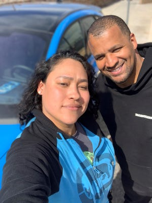 Pearl Tirado, left, met her brother Sergio Rodriguez for lunch in El Paso, Texas on Feb. 26, 2021. He stopped while driving from California to Georgia in his 2021 Mustang Mach-E.
