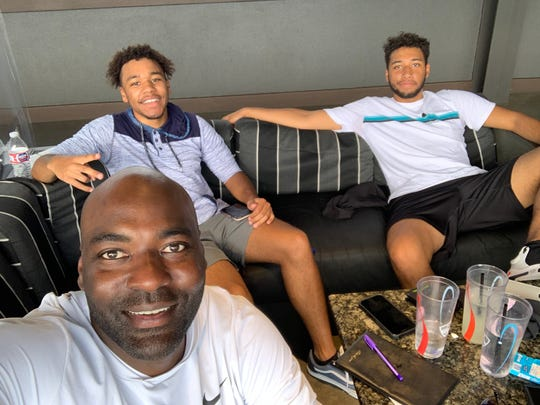 Kenny Beatty with his sons Kayden (left) and Kamby (right).