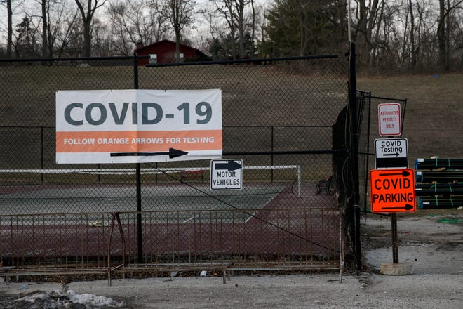 Signs direct traffic to a state-run COVID-19 testing site at Happy Hollow Elementary, Monday, March 8, 2021 in West Lafayette. The site is staffed by Logistics Health Incorporated.