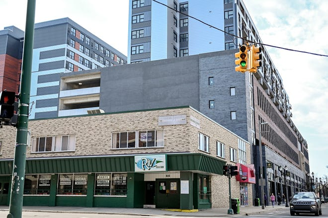 The southern wall of the Albert Avenue parking garage, seen from the M.A.C. Avenue intersection on March 8, 2021 in downtown East Lansing, is the proposed site of a new mural.