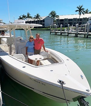 """Don and Rosemary Harty aboard """"Bella Rose."""""""