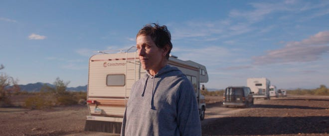 """Frances McDormand watches as some of her fellow road warriors depart in a scene from """"Nomadland."""" The movie is expected to collect a caravan of Oscar nominations, including one for best picture, when the Academy Award nominations are announced March 15."""