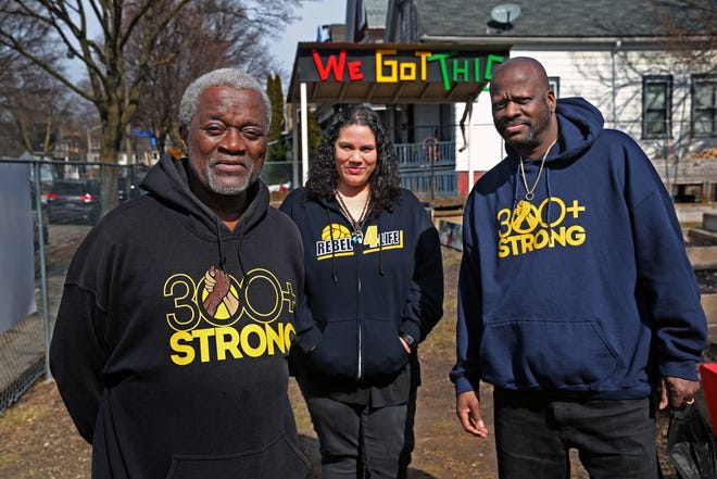 Andre Lee Ellis, from left, from We Got This, along with Dawn Barnett, co-executive director, and her husband, Victor, executive director of the Running Rebels, gather Tuesday, March 9, 2021, at the garden at West Ring and North 9th streets. The groups will be merging their resources to work together to enhance their youth community outreach programs in the future. The Barnetts started the Running Rebels program 40 years ago.