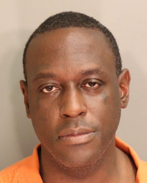 Krogius Ryan Scott, 39, was charged with first-degree robbery and first-degree domestic violence - assault Sunday, March 7, 2021.