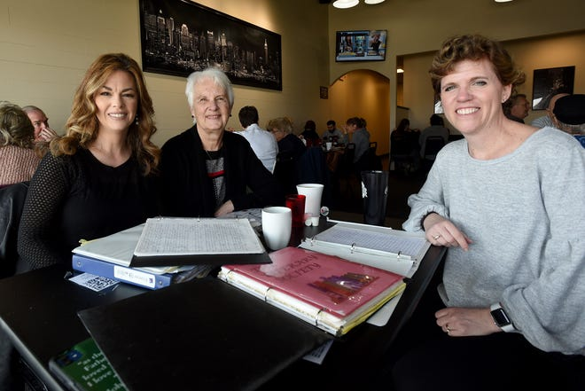 Melia Lamoreaux, Carol Murray, and Angela Besse meet with years of notes from their book club meetings. Besse, her best friend Lamoreaux, of Mansfield, and their moms created a monthly book club that met for 23 years. In November Angela's mom, Jackie Reed, of Granville, passed away and the group meet to discuss their readings of the books of Esther and Ruth from the Bible.