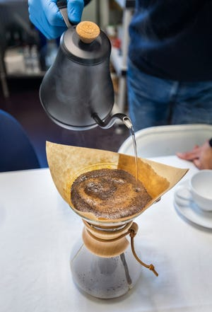 The pour-over method of coffee brewing works well for enhancing the natural flavors of the beans.