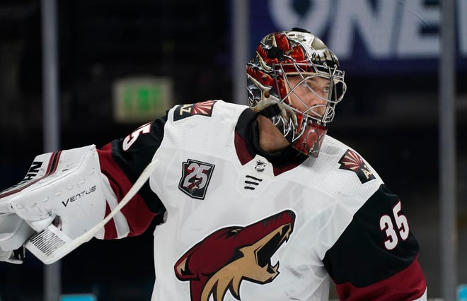 Arizona Coyotes goaltender Darcy Kuemper prepares for play to resume after a timeout in the first period of an NHL hockey game against the Colorado Avalanche, Monday, March 8, 2021, in downtown Denver. (AP Photo/David Zalubowski)