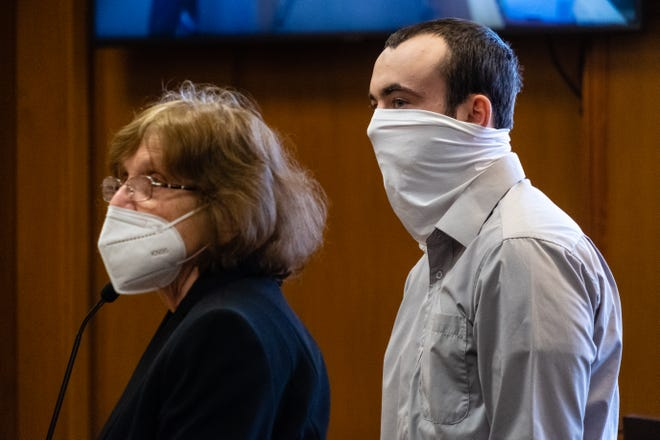 Devin Convery, right, stands at the defense podium next to his attorney, Sharon Parrish, during a probable cause hearing Tuesday, March 9, 2021, in the St. Clair County Courthouse in Port Huron. Convery is charged with open murder and assaulting/resisting/obstructing a police officer related to the stabbing death of Steven Kelch.