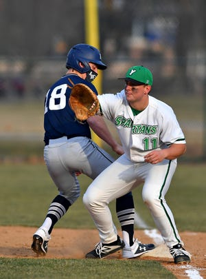 York College's Jack Barry is seen here waiting for a pickoff throw at first base on Tuesday vs. Lebanon Valley at Jaquet Field in York. On Wednesday, Barry finished with four RBIs, including a three-run homer, in the Spartans' 7-1 victory at Lebanon Valley.
