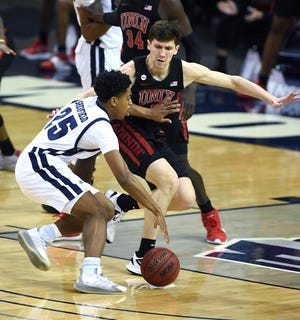 Nevada's sweep of UNLV in men's basketball helped the Wolf Pack to edge UNLV in the year-long Silver State Series competition.