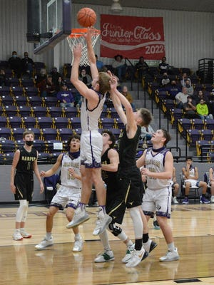 San Saba High School's Logan Glover (in white) puts the ball up on the glass during a District 29-2A boys basketball game in San Saba during the 2021 season.