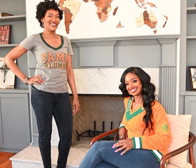 Ayana Parson (standing) and Arian Simone (seated); two FAMU School of Business and Industry graduates and partners in The Fearless Fund.