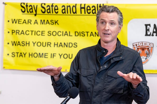 California Gov. Gavin Newsom discusses vaccine equity during his visit to Earlimart Veteran's Memorial Building on Monday, March 8, 2021. Tulare County Board of Supervisors Chairwoman Amy Shuklian introduced the governor and repeated the need to provide vaccine protection for farmworkers.