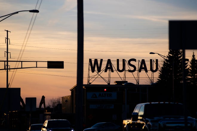"""A """"Wausau"""" sign is silhouetted in the sunset at the intersection of South 28th Avenue and Sherman Street in Wausau."""