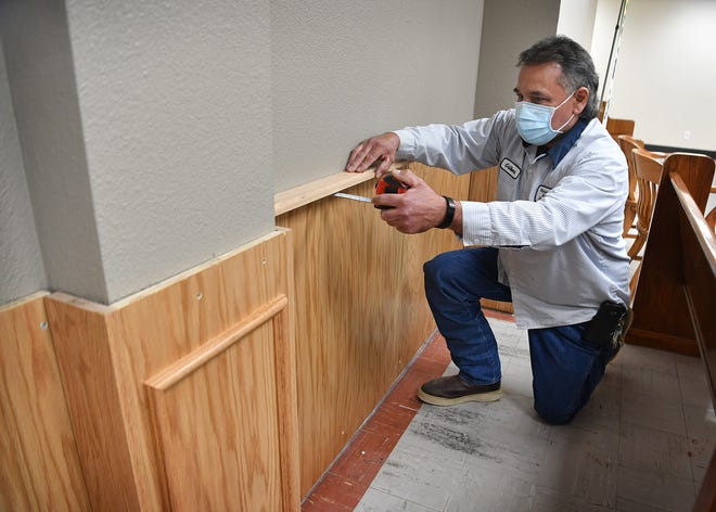 Gilbert Garza Luera Jr. takes measurements as he plans out a remodeling project at the Wichita County Courthouse. His project includes new texture and paint on the walls, and Oak trim and wainscotting.