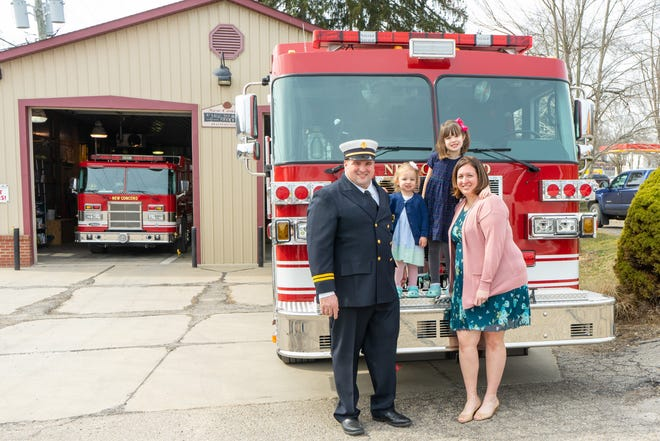 Matt Hamsher is New Concord's first new fire chief since 1992. Supporting him during his swearing-in ceremony were his wife, Lindsay, and their daughters, Charlotte and Caroline.