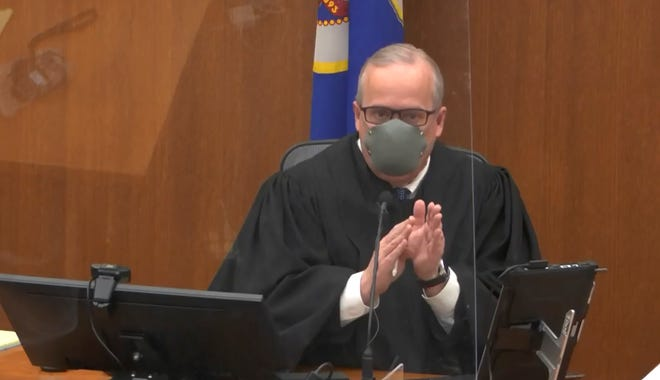 In this image from video, Hennepin County Judge Peter Cahill presides over pretrial motions before jury selection in the trial of former Minneapolis police officer Derek Chauvin on Tuesday, March 9, 2021 at the Hennepin County Courthouse in Minneapolis.  Chauvin is charged in the May 25, 2020 death of George Floyd.