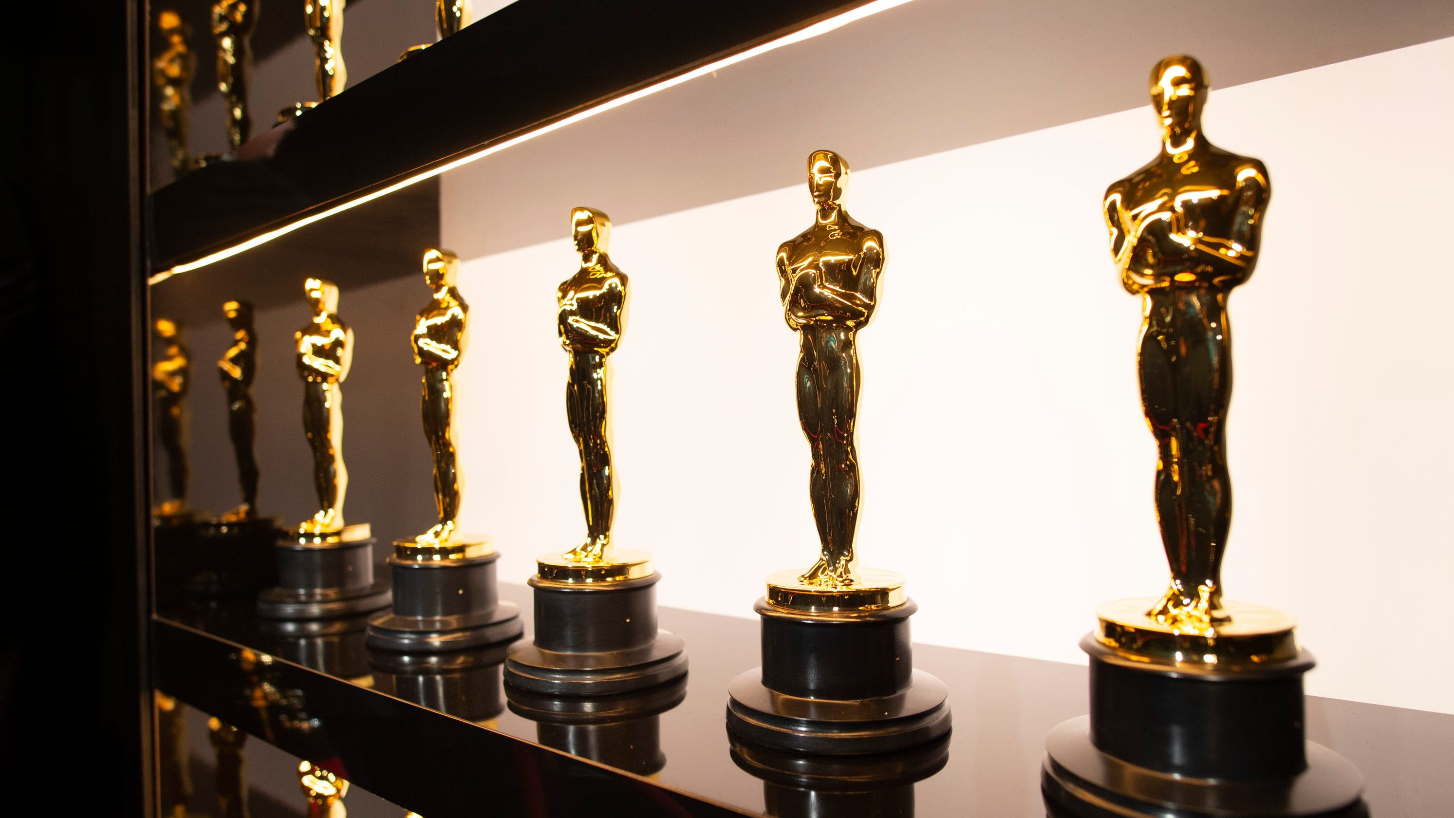 Oscar producers talk unprecedented show amid COVID, the 'teeny' red carpet and the role of masks