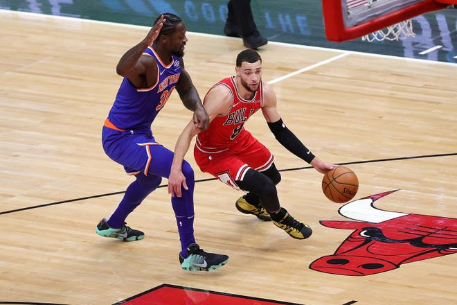 Knicks forward Julius Randle (left) and Bulls guard Zach LaVine are the favorites to win the NBA's Most Improved Player award.