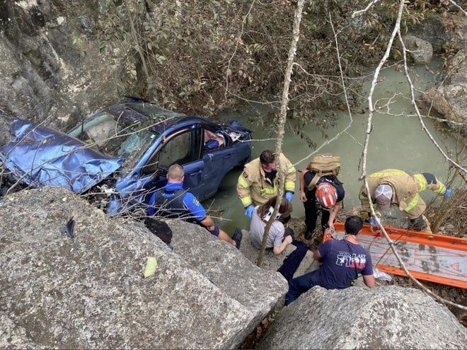 A driver is extricated from a creek bed along Westlake Drive before being taken to Dell Seton Medical Center with serious injuries.