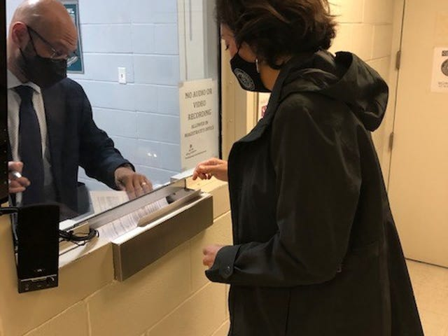 County Attorney Delia Garza launched a early case review process for Travis County on March 1 as part of a public safety reform plan. Garza with Judge Alfred D. Jenkins picks up the probable cause affidavits from the magistrate.