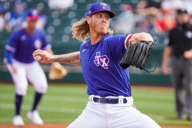 Texas Rangers pitcher Mike Foltynewicz delivers during the team's spring training game against the Los Angeles Dodgers in Surprise, Ariz., on Sunday. The former All-Star was acquired by Texas after the Atlanta Braves cut him loose.
