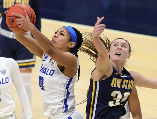 Kent State junior guard Hannah Young and Buffalo forward Summer Hemphill battle for a rebound during the second half of Wednesday's MAC Tournament battle at Rocket Mortgage FieldHouse in Cleveland.