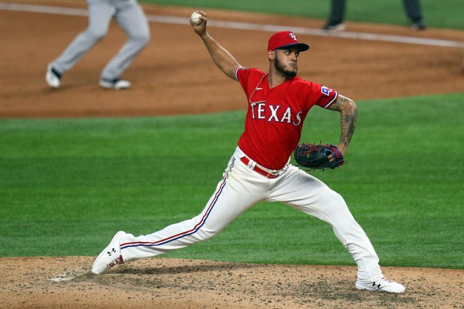 Texas Rangers relief pitcher Jonathan Hernandez works the sixth inning in a baseball game against the Oakland Athletics in Arlington in this Sept. 12, 2020, file photo. Hernandez was shut down from pitching for at least four weeks because of a ligament sprain in his elbow.