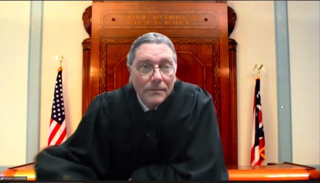 Judge Ronald Forsthoefel presides over the Mohican Young Star Academy injunction hearing on Wednesday afternoon in Ashland County Commons Pleas Court.
