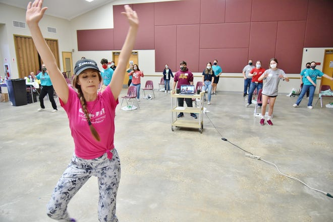 Moriah Istre Hargrave leads 4-H'ers through an exercise routine during the recent Challenge Camp for the LSU AgCenter Southwest Region.