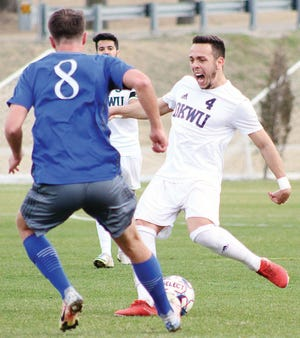 Oklahoma Wesleyan University veteran Ognjen Stevic, right, displays the intensity that flowed like a waterfall in Tuesday's men's soccer clash with visiting John Brown University.