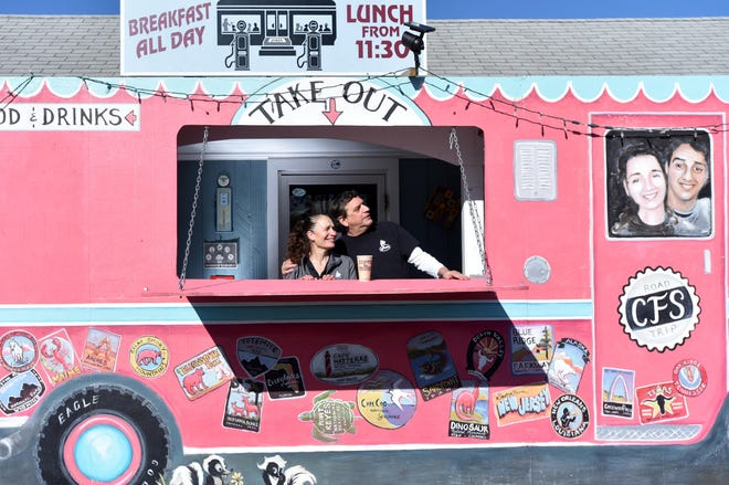 """Chatham Filling Station owners Caren and Rik Morse created a takeout window, painted with a """"road trip"""" theme by Helen Kelsye to reduce the number of people in their small restaurants during the pandemic. STEVE HEASLIP/CAPE COD TIMES"""