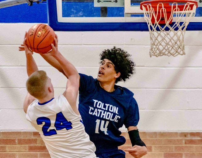 Tolton's Jevon Porter (14) goes for a block against Montgomery County's Collin Parker (24) during a Class 4 sectional game Tuesday night at Montgomery County High School.