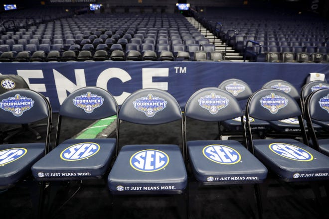 An empty team bench area is shown March 12, 2020, at Bridgestone Arena in Nashville, Tenn., after the Southeastern Conference men's basketball tournament was canceled due to the coronavirus pandemic.