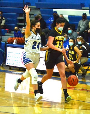 Senior forward Vivian Dyer (right) finished with eight points and eight rebounds for the Pellston varsity girls basketball team in a loss at Johannesburg-Lewiston on Tuesday.