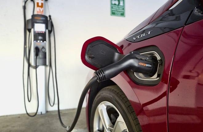 A Chevrolet Volt hybrid car fills up at a charging station. (AP Photo/Richard Vogel, File)