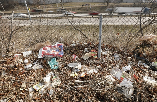 Spring is not the only thing about to bloom: Trash lines the sides of Interstate 1-71 south between the 11th and 5th avenue exits in Columbus in what is a perennial issue as the weather warms and the snow melts.