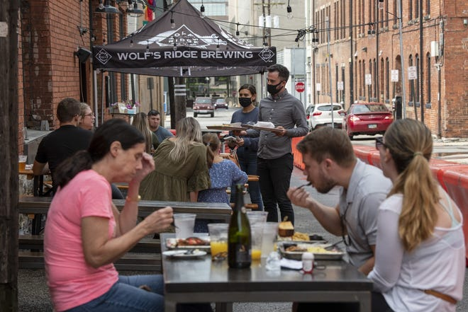 Wolf's Ridge Brewing's patio in the alley brought it vastly better sales in 2020. Now it will have the option to operate the dining room at pre-pandemic capacity.