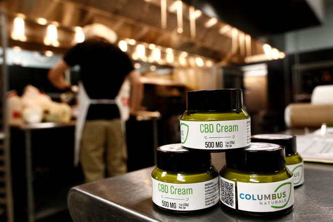 Columbus Naturals processes hemp to make CBD cream. As a result, owners Erik Bogard and Olivia Rojas had to call 20 banks to get an account.