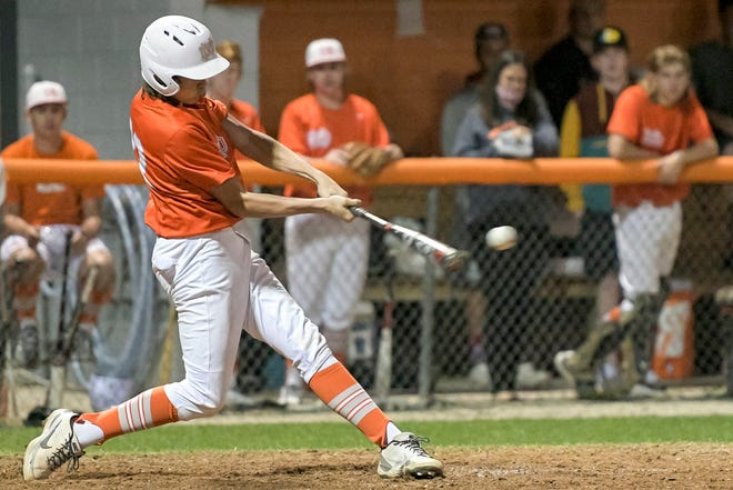 Mount Dora's Braeden Tew (22) doubles in two runs in the sixth inning of Tuesday's game against Mount Dora Christian Academy at Heim Field in Mount Dora. Tew's double was the game-winning hit. [PAUL RYAN / CORRESPONDENT]